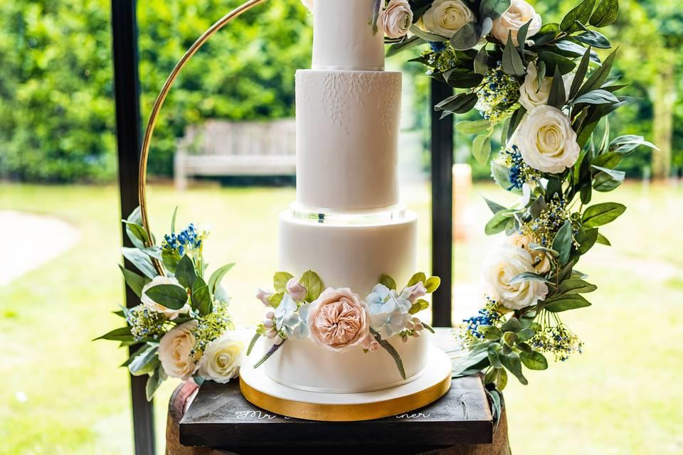 Pastel sugar flowers wedding cake