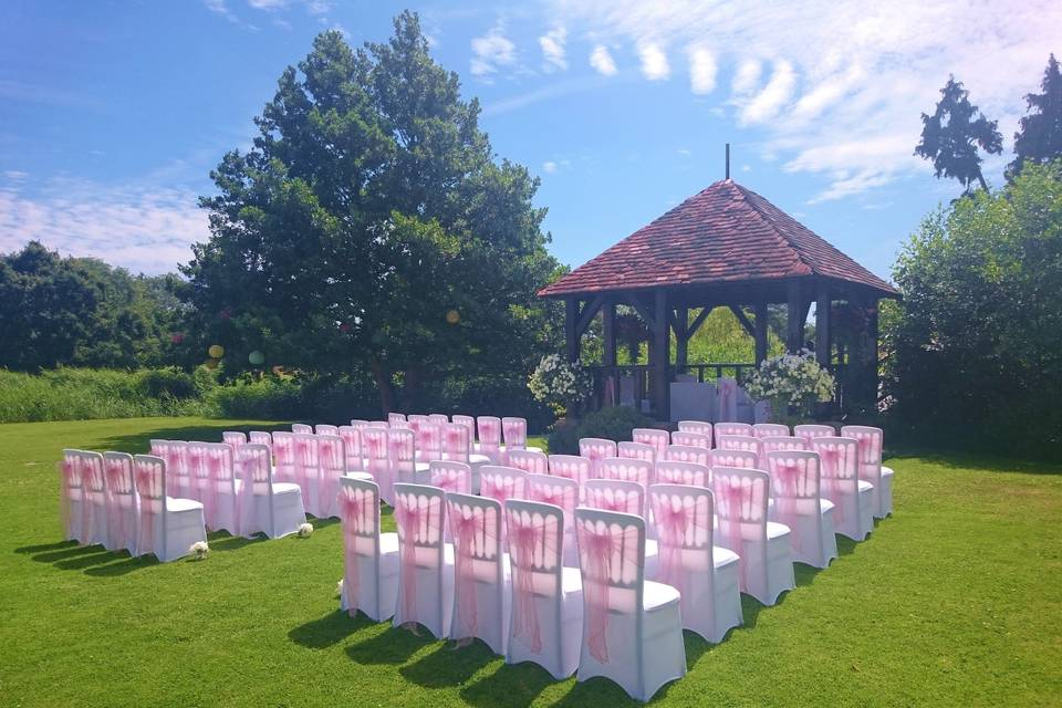 Outside ceremony with gazebo in pink