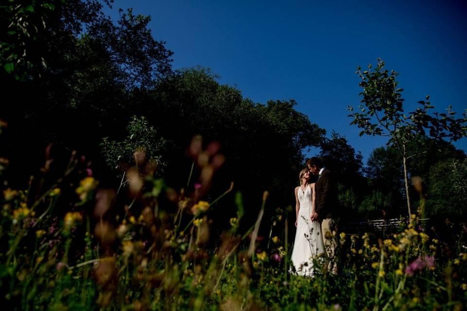 Couple kissing and holding hands - Richard Murgatroyd Photography