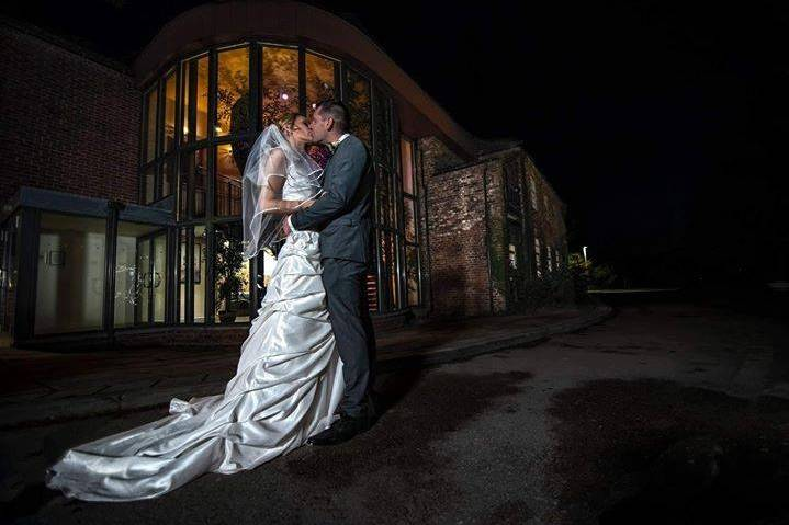 Newlyweds kissing - photograph by Dave Mahoney