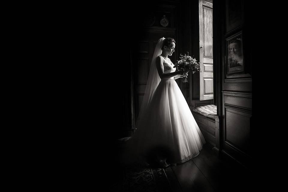 Bride standing by a window - Robin Goodlad Photography