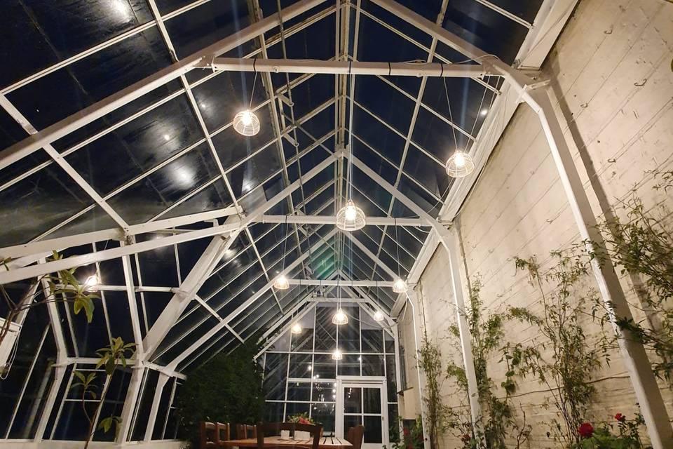 Conservatory lit up for dinner