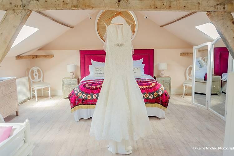 Brides dress hanging in the honeymoon suite